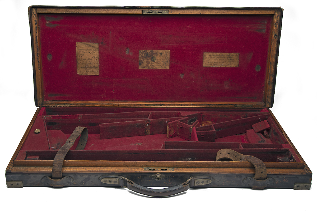 JAMES PURDEY & SONS A BRASS-CORNERED OAK AND LEATHER DOUBLE GUNCASE, fitted for 29in. barrels, the
