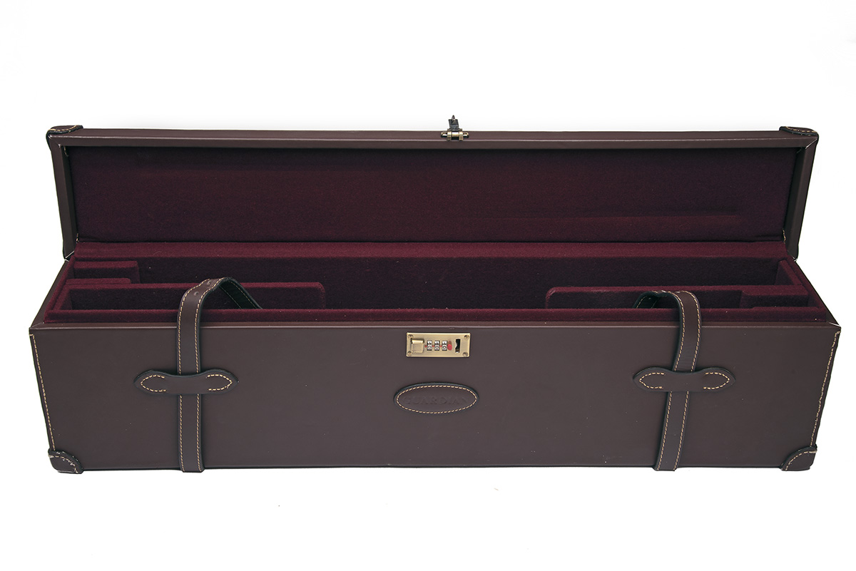 AN UNUSED LEATHER DOUBLE UNIVERSAL GUNCASE, fitted for 31in. barrels, the interior lined with maroon