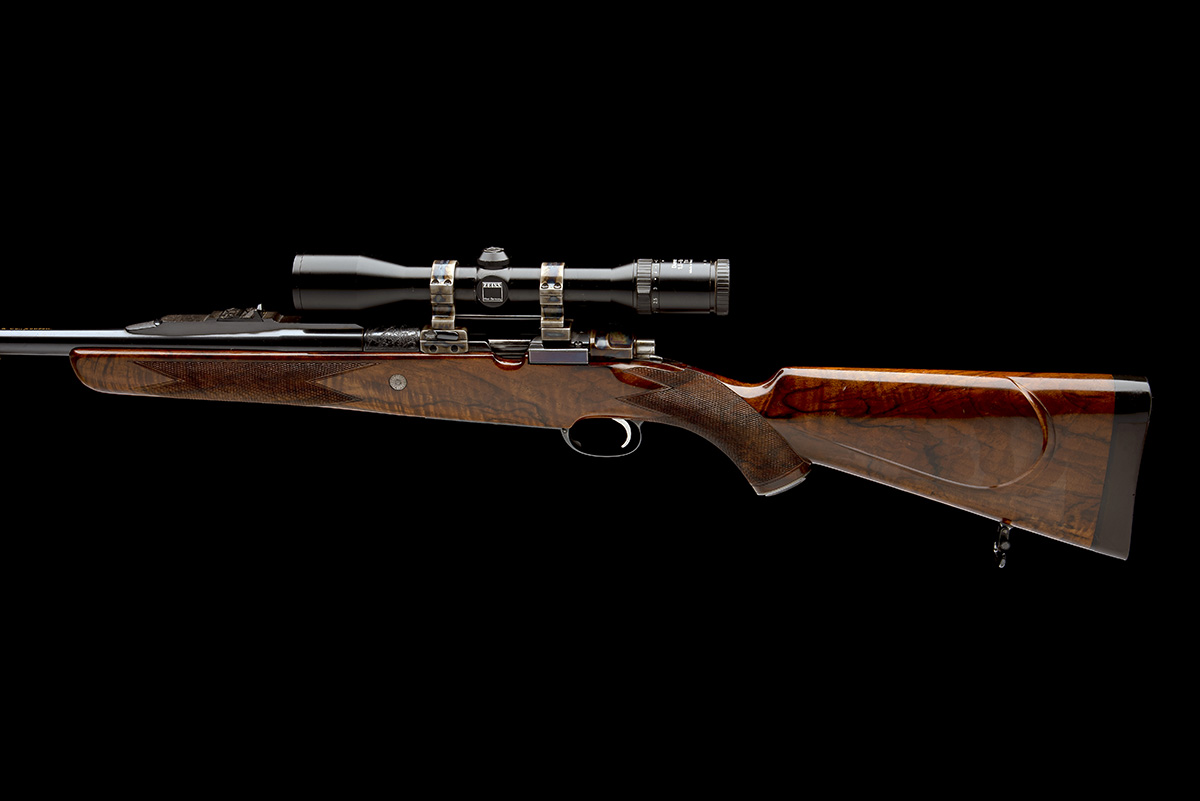 J. RIGBY & CO. A FINE, HUNT-ENGRAVED .375 H&H MAGNUM BOLT-MAGAZINE SPORTING RIFLE, serial no. - Image 2 of 12