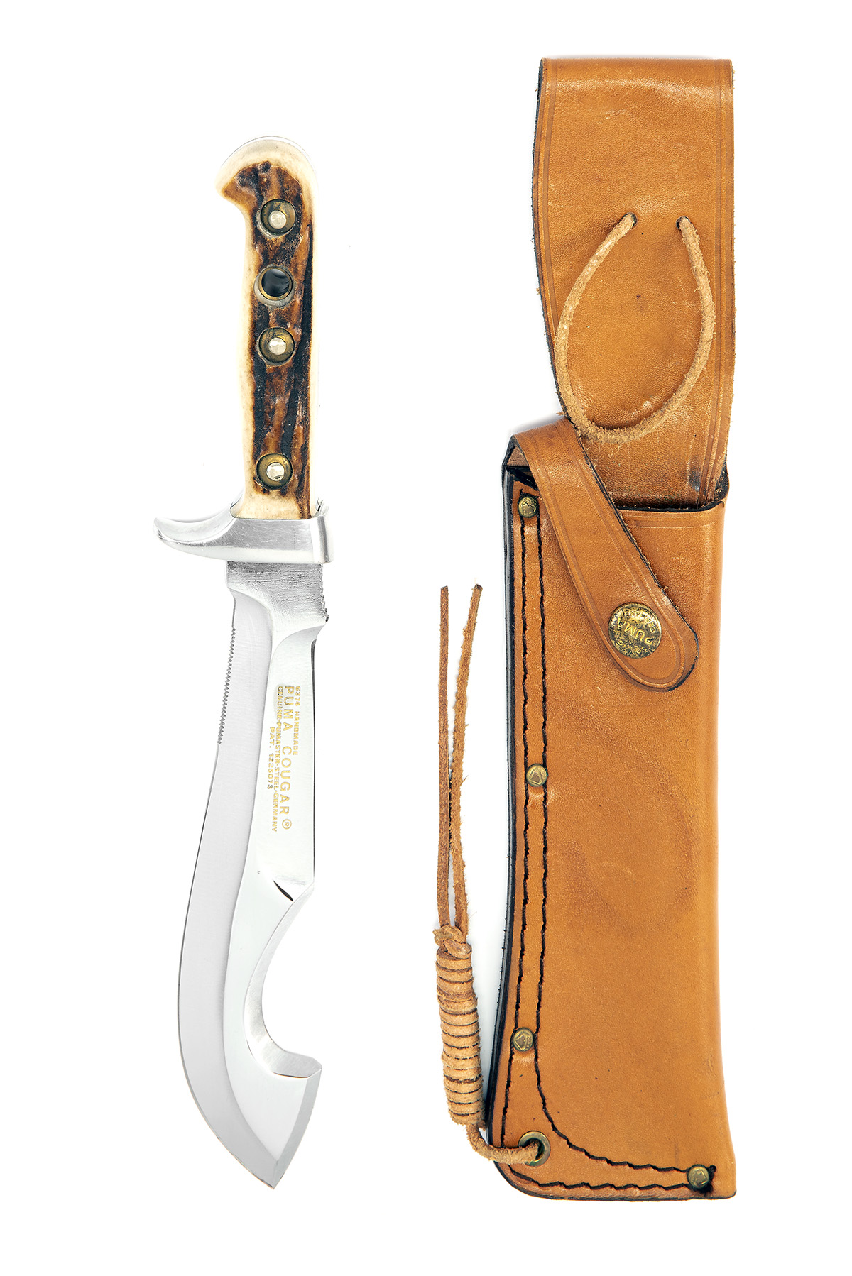 PUMA, GERMANY A SCARCE CASED SPORTING-KNIFE, MODEL '6374 COUGAR', serial no. 83774, for 1977, the