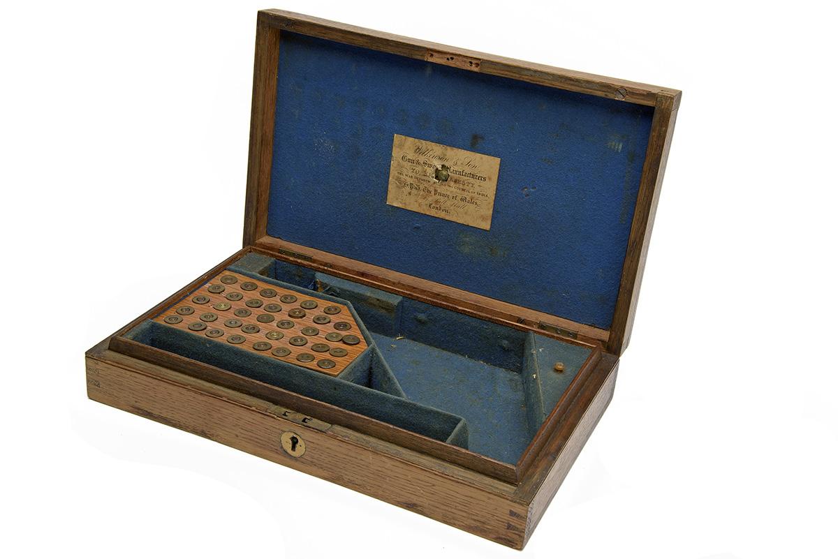 WILKINSON, LONDON AN ENGLISH MARKET OAK CASE FOR A PRIZE WEBLEY-WILKINSON REVOLVER, circa 1880-85,