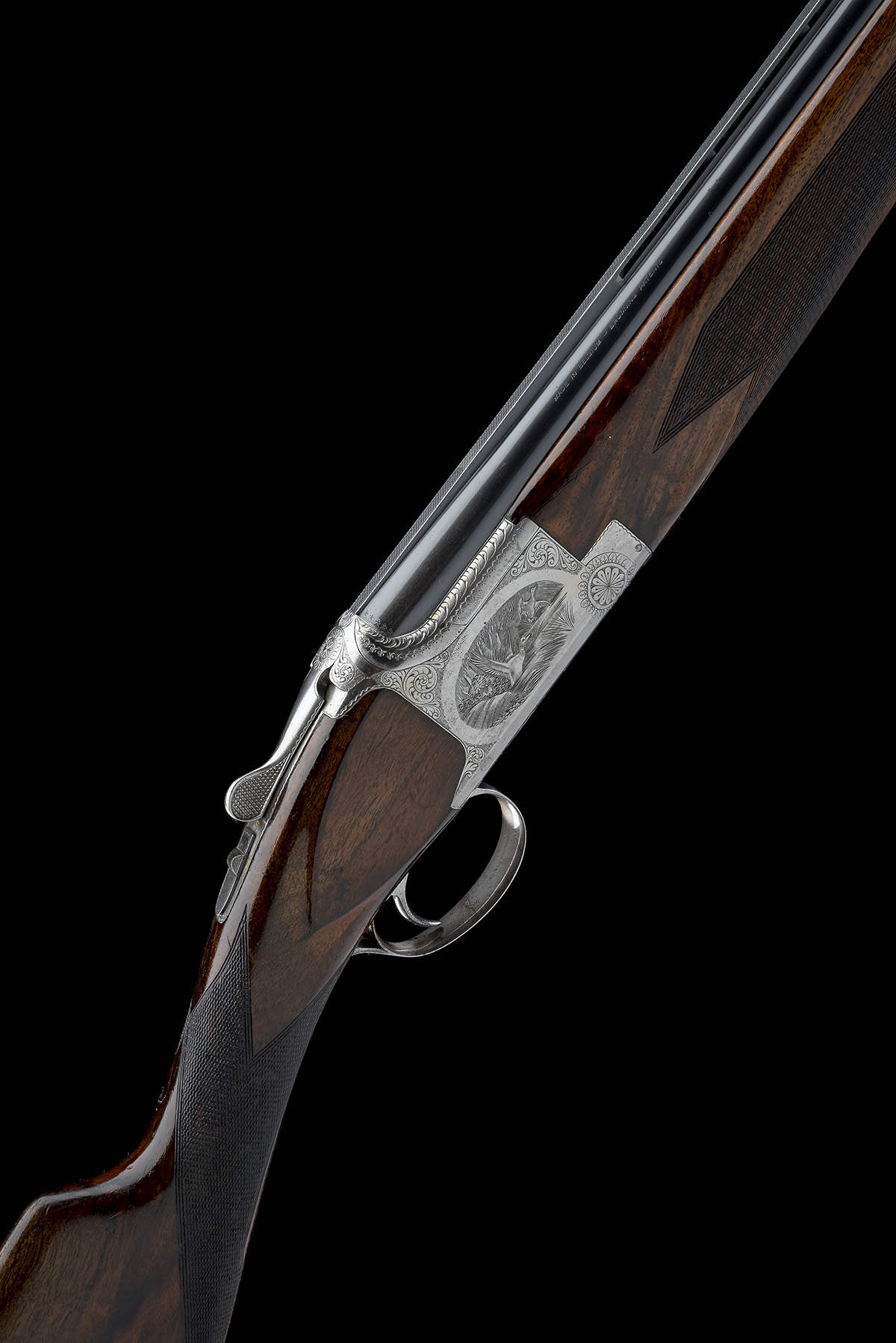 FABRIQUE NATIONALE A 12-BORE 'B2G' SINGLE-TRIGGER OVER AND UNDER EJECTOR, serial no. 34112 S74, 27