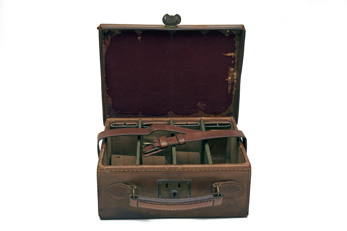 A BRASS-CORNERED CANVAS AND LEATHER CARTRIDGE MAGAZINE, for approx. 200 cartridges, the interior