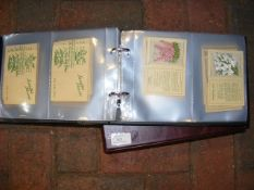 An album of Kensitas silk flower cigarette cards
