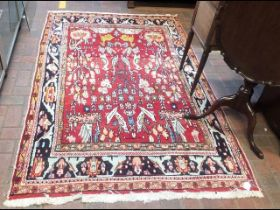A Middle Eastern rug with geometric border - 220cm