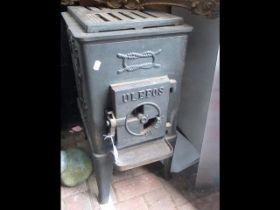 A cast metal stove - 64cms high