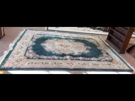 A Chinese carpet with floral border and centre med