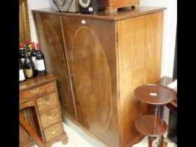 A 19th century storage cupboard with slides to the