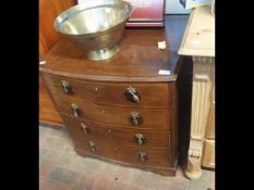 An antique mahogany commode with dummy drawer fron