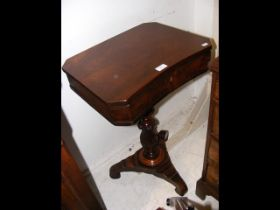 A 19th century mahogany work table on shaped suppo