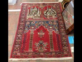 A Middle Eastern prayer rug - 130cm x 95cm