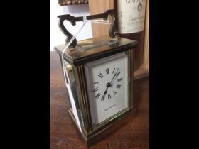 A 12cm high brass cased carriage clock by Mappin &