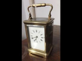 A 14cm high brass cased carriage clock