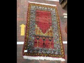 A Middle Eastern prayer rug - 140cm x 80cm