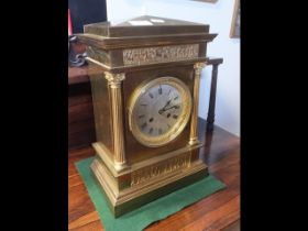 A 38cm high brass mantel clock with striking movem