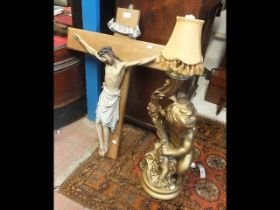 A gilt cherub table lamp together with plaster fig