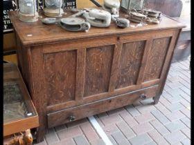 An antique oak paneled mule chest - 130cms