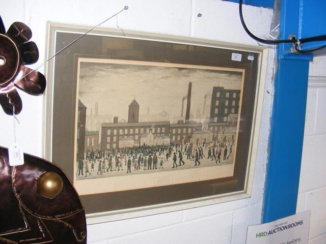 A framed print of L.S Lowry's 'Outside the Mills'