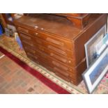 An oak plan chest with six drawers - width 115cms