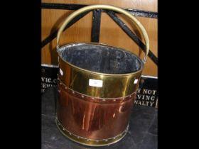 Old copper and brass circular coal scuttle