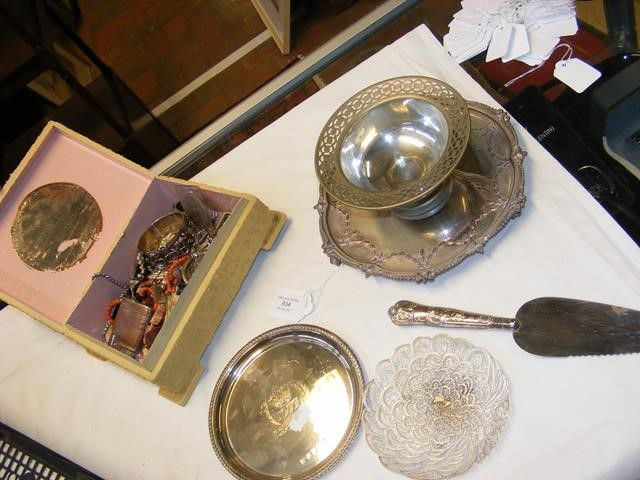 A small circular silver salver together with other