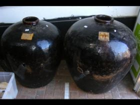 A large glazed oriental garden pot, together with
