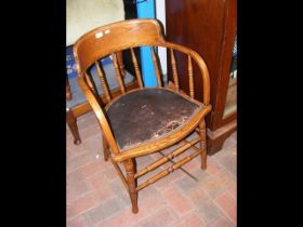An antique tub style office chair