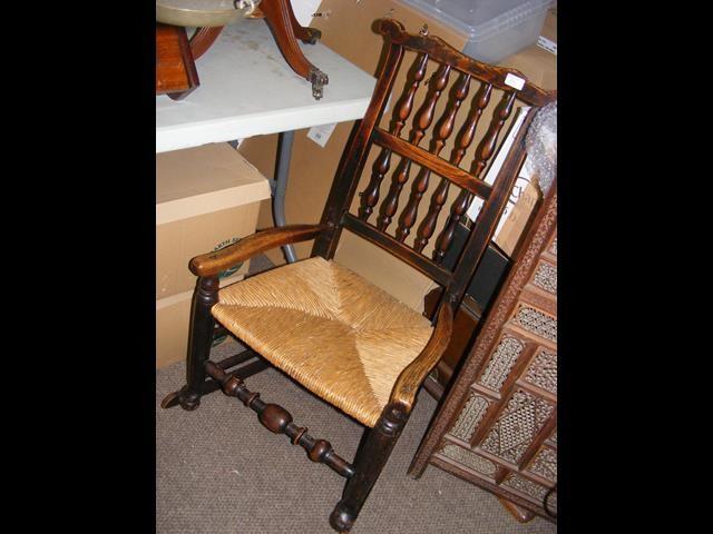 A Victorian Lancashire oak spindle back rush seat