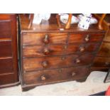 An antique chest of two short and three long gradu