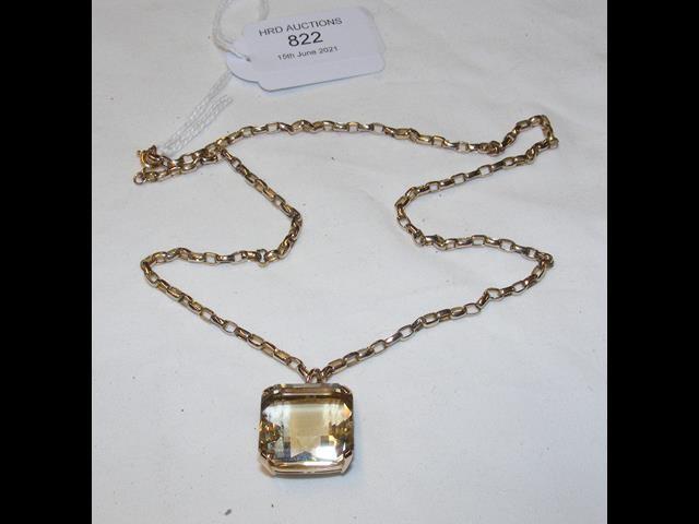 A square set gem pendant on gold chain