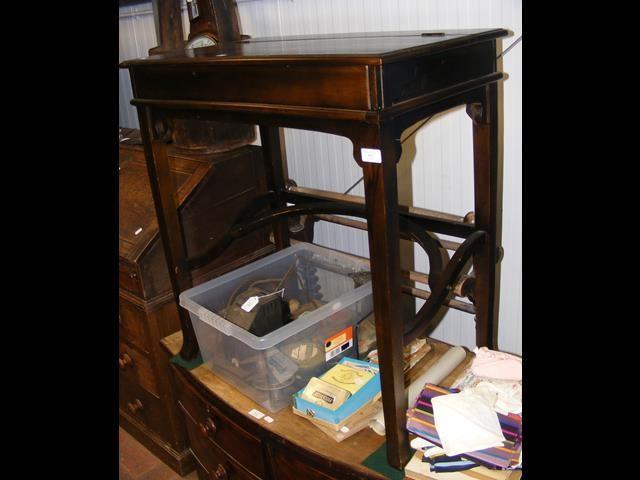 A mahogany writing desk with sliding action