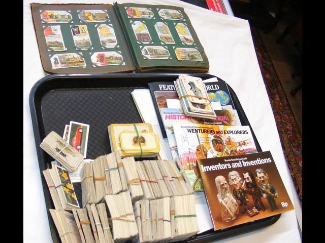 A tray containing collectable cigarette cards