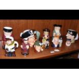 A large collection of Royal Doulton character jugs