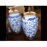 A pair of Oriental style table lamps with blue gla