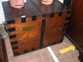 An old metal bound silver chest with brass plaque