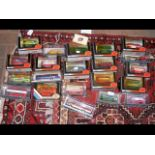 A selection of 21 boxed die cast model busses and