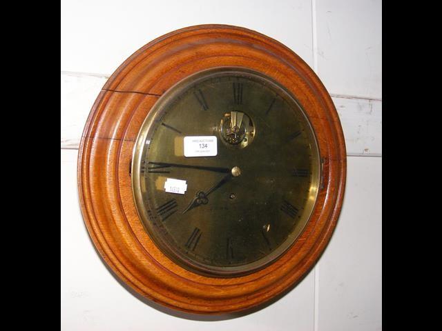 An antique circular wall clock by John Bell of Sou
