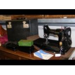 A Singer Featherweight Model 221K portable electri