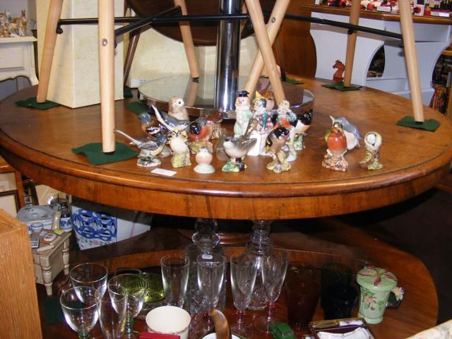 A circular pedestal coffee table with claw feet an