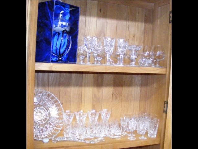 An assortment of Waterford cut crystal glass including others – on two shelves