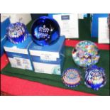 Two boxed Caithness paperweights together with thr