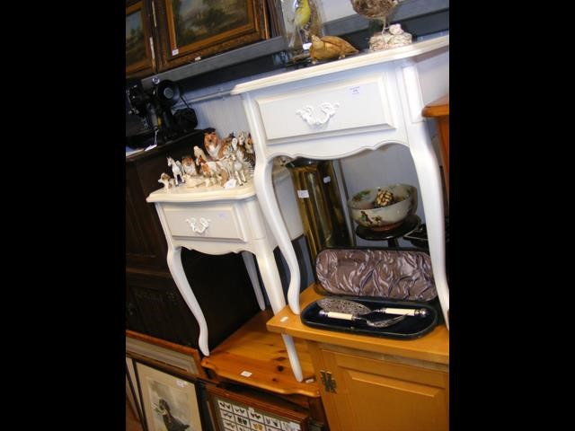 A pair of cream Laura Ashley bedside tables