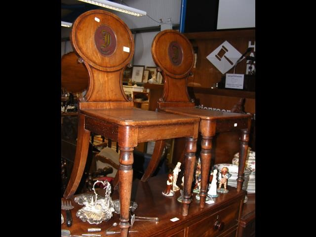 A pair of 19th century shield back hall chairs