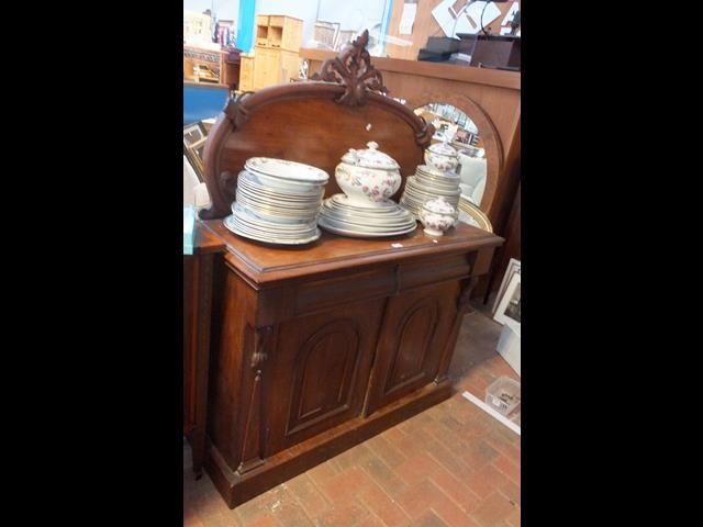 A Victorian mahogany chiffonier with shaped back