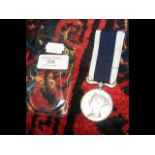 A Naval Long Service and Good Conduct medal with r