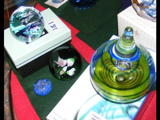 Two boxed Caithness paperweights together with two
