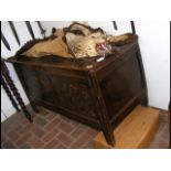 A period oak panelled coffer with carved front