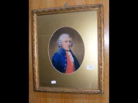 A half length portrait of man wearing blue coat an