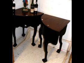 A pair of Victorian corner tables on carved cabrio