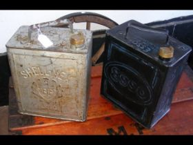 An old Esso petrol can, together with a Shell petr